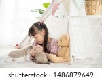 Stock photo asian little girl playing with kittens at home relationship concept 1486879649