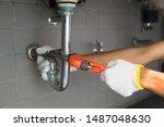 plumber fixing white sink pipe...   Shutterstock . vector #1487048630