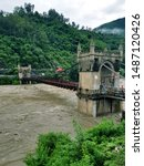 Small photo of One and half century old Victoria Bridge mandi himachal pradesh india over river Beas which is in spate and water is about to touch the bridge.This historical bridge connect old and new mandi.
