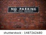 No Parking Sign At A Brick Wall.