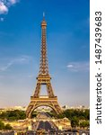 Small photo of Eiffel tower in summer, Paris, France. Scenic panorama of the Eiffel tower under the blue sky. View of the Eiffel Tower in Paris, France in a beautiful summer day. Paris, France.