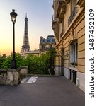 Small photo of Cozy street with view of Paris Eiffel Tower in Paris, France. Eiffel Tower is one of the most iconic landmarks in Paris. Architecture and landmark of Paris. Eiffel tower in summer, France.