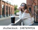 beautiful girl in white sweater ... | Shutterstock . vector #1487694926