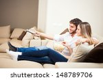 young couple preparing to watch ...   Shutterstock . vector #148789706