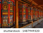 Small photo of Prayer wheels Xiahe, labrang monastery, Gansu, China. The text means om ma ni pad me hum, meaning generosity, ethics, patience, diligence, renunciation and wisdom.