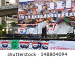 Small photo of BANGKOK,THAILAND-AUGUST 5 : Unidentified people from anti-government group called Pitak Siam listen to Air Marshal Watchara Ritthakanee speech at Lumphini Park on August 5, 2013 in Bangkok, Thailand.