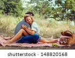 couple on picnic  sitting...   Shutterstock . vector #148820168