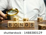 Small photo of Wooden blocks with the word Bonds and businessman. A bond is a security that indicates that the investor has provided a loan to the issuer. Equivalent loan. Unsecured and secured bonds.
