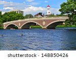 Stock photo john w weeks bridge over charles river and clock tower in harvard university campus in boston ma 148850426
