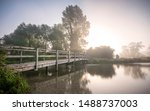 Early morning footbridge over the River Test at Houghton near Stockbridge, Hampshire UK