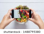 Small photo of Calories counting and food control concept. woman using application on smartphone for scanning the amount of calories in the food before eat