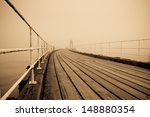 Whitby Pier With Fog In The...