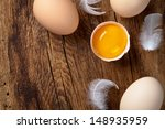 Fresh Eggs On Wood Background....