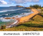Small photo of Norfolk Island, South Pacific, Australia: Cemetery Bay, fringed by Norfolk island pines is another spectacular vista on Norfolk island.