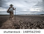 Women Standing On Dry Soil And...