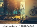 Autumn RV Camping. Modern Camper Van During Late Sunny Fall Afternoon. Scenic RV Park. - stock photo