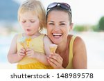 happy mother and baby eating... | Shutterstock . vector #148989578
