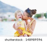 Mother Kissing Baby While...