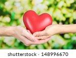 heart in hands on nature... | Shutterstock . vector #148996670