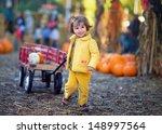 Cute Toddler Girl At A Pumpkin...