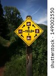 "Sign ""Yield"" on mountain trail - stock photo"