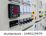 Small photo of Selective focus the power meter on Electrical switch gear high Voltage motor control center cabinet in power plant,Breaker module,Electrical selector switch,button switch
