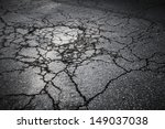 Dark Asphalt Road With Cracks....