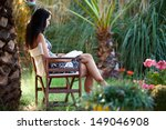 Woman Is Relaxing In A Tropica...