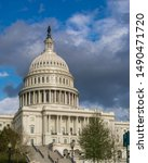 Small photo of US Capitol under a blustery sky