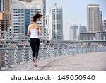 running in city park. woman... | Shutterstock . vector #149050940