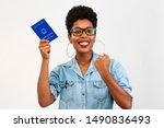 Small photo of Brazilian woman with document work and social security, (Carteira de Trabalho e Previdencia Social) on white background