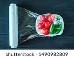 Using food film for vegetables storage in fridge. Top view