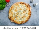 Small photo of Pizza Quattro formaggi on beautiful grey table