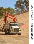 Track Hoe Excavator Filling Up...