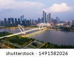 Nanjing Eye pedestrian bridge and skyline of Nanjing city in Hexi area in summer. This image was taken with a drone flying in the air.