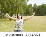 an attractive woman on the grass - stock photo