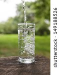 pouring water into a glass in...   Shutterstock . vector #149188526