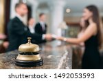 Small photo of Picture of guests getting key card in hotel