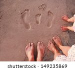 Family Footprints In The Sand...