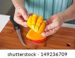 female hands cutting a fresh... | Shutterstock . vector #149236709