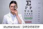 Smiling optometrist looking...