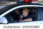 Police Woman Receiving Call On...