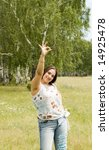 pretty gesturing woman in nature - stock photo