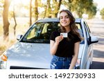 Small photo of Teenader is happy to receive driving licence. Concept of buying first car