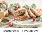 Homemade poppy seed cake for Christmas with orange and cranberry - stock photo