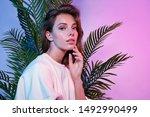 beautiful female touching face... | Shutterstock . vector #1492990499