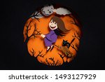 Small photo of Happy All Saints Day hand cut illustration. Beldam on broom going to coven with mystical kitten. Spooky forest in dark night on full moon with clouds background