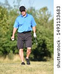 Small photo of Retiree Male Golfer And Happiness With Golf Club On Golf Course
