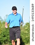 Small photo of Golfer With Golf Club On Golf Course