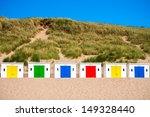 Multi Colored Beach Huts In...